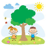 Boy and girl near big tree Royalty Free Stock Photography