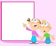 Boy and girl near blackboard Stock Photo