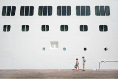 Boy and girl near passenger liner at dock Stock Photo