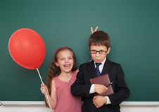 Boy and girl near school board Royalty Free Stock Photography
