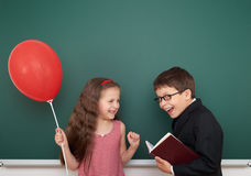 Boy and girl near school board Stock Images