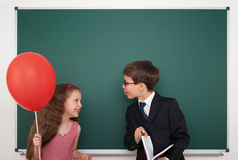 Boy and girl near school board Stock Photography