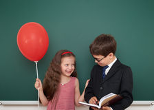 Boy and girl near school board Royalty Free Stock Photos