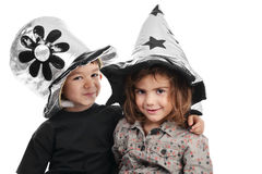 Boy and girl with nice hats Royalty Free Stock Photo