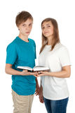 Boy and a girl with an open book Stock Photos