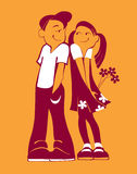 Boy and girl on an orange background. Boy and girl with flowers on an orange background Stock Photo