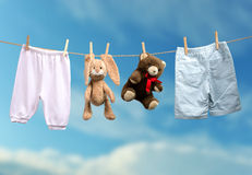 Boy or girl? on the outdoor clothesline Stock Photography