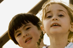 Boy and girl outdoors. Portrait of preschool Asian boy and Caucasian girl outdoors Royalty Free Stock Photos