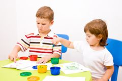 Boy and girl paint colors Royalty Free Stock Photography