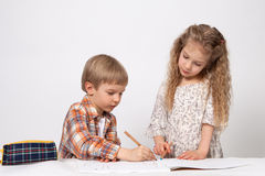 Boy and girl paint Stock Photos