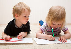 Boy and girl are painting Stock Photo