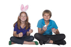 Boy and girl painting easter eggs Royalty Free Stock Photos