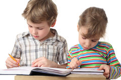 Boy and girl are painting in notebooks Stock Photo