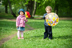 Boy and girl in park Stock Images