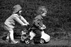 Boy and girl in park with toy car Royalty Free Stock Photos