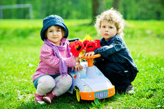 Boy and girl in park with toy car Royalty Free Stock Photo