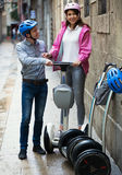 Boy and girl parking their segways Royalty Free Stock Photography