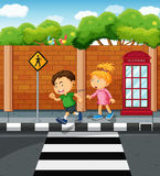 Boy and girl on the pavement Stock Image