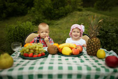 Boy and girl on picnic in park Royalty Free Stock Images