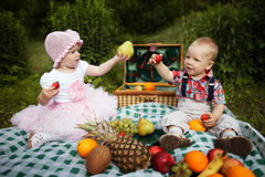 Boy and girl on picnic in park Royalty Free Stock Photo