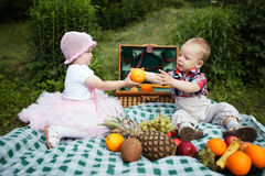 Boy and girl on picnic in park royalty free stock photography