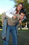 Boy and girl piggy back riding. Young boy and girl piggy back riding Royalty Free Stock Photos