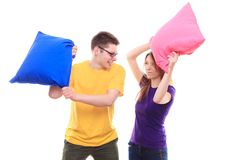 Boy and girl pillow fight Royalty Free Stock Image