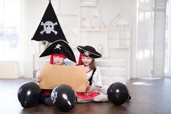 Boy and girl playing pirates. They`re wearing pirate costumes. royalty free stock photo