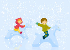 Boy and girl plaing outdoore in winter day. Happy boy and girl astride snowdeer playing outdoor in winter day Royalty Free Stock Photos