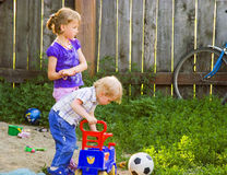 The boy and the girl play. On a grass Royalty Free Stock Image