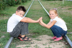 Boy and girl play with each other while sitting on Royalty Free Stock Photography