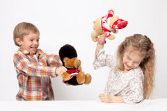 The boy and the girl play. And quarrel Stock Photos