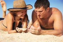 Boy and girl play sand Stock Photos