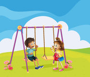 A boy and a girl at the playground Stock Photo