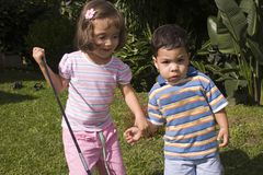 Boy and girl playing stock photo