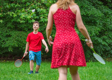 Boy and girl playing badminton Stock Images