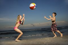 Boy and girl playing with ball Royalty Free Stock Photos