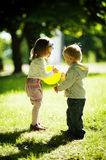 Boy and girl playing with ball Royalty Free Stock Photography