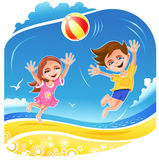 Boy and girl playing with ball on the beach Stock Photos