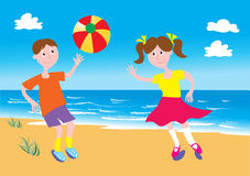Boy and girl playing ball on a beach. Boy and girl playing with a beach ball on a sandy beach with blue sky and fluffy clouds Royalty Free Stock Images