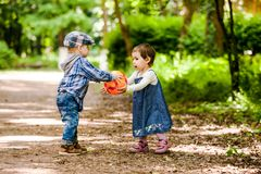 Boy and girl. Are playing with ball outdoor Royalty Free Stock Photos