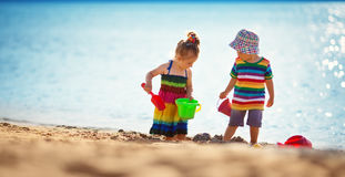 Boy and girl playing on the beach Royalty Free Stock Photos