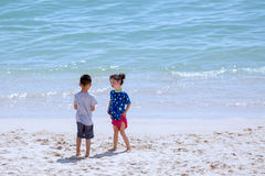 Boy and girl. A boy and a girl are playing on beach in a sunny day
