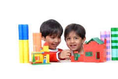 Boy and girl playing with blocks. Brother and sister making house with colorful blocks Royalty Free Stock Photos