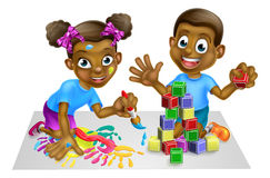 Boy and Girl Playing with Blocks and Paint Royalty Free Stock Photos