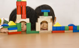 Boy and girl playing building blocks. Picture of a little chinese boy and girl playing building blocks together happily Stock Photography