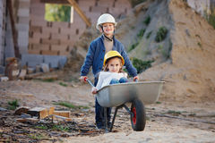 Boy and girl playing on construction site Royalty Free Stock Photos