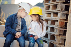 Boy and girl playing on construction site Royalty Free Stock Photography