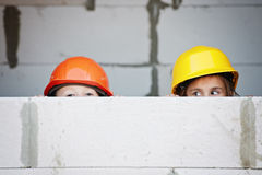 Boy and girl playing on construction site Stock Photos