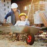 Boy and girl playing on construction site Stock Images